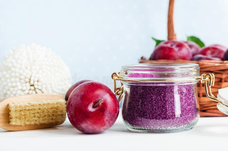 Homemade plum face and body scrub/foot soak/bath salt in a glass jar. DIY cosmetics and spa. royalty free stock photo