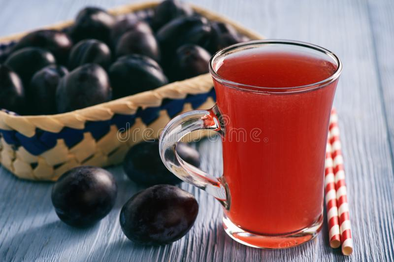 Homemade plum kissel on wooden table. stock photos