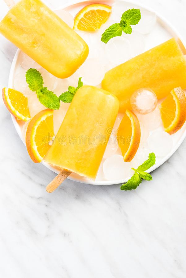 Homemade popsicles made from orange juice royalty free stock images