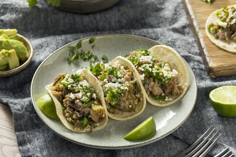 Homemade Pork Carnitas Tacos. With Cilantro and Cojita stock photos