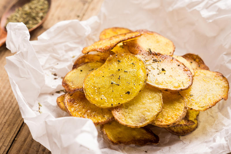 Homemade potato chips with spices stock photo