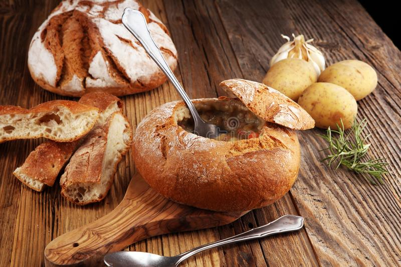 Homemade potato cream soup, served in bread bowl.  royalty free stock photo
