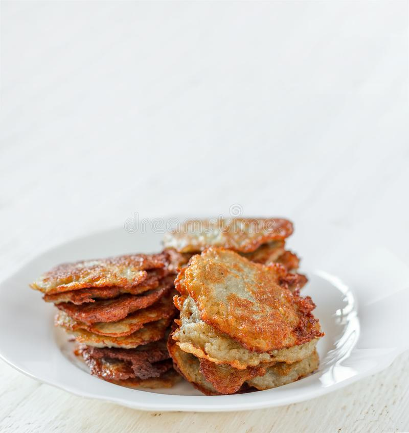 Homemade potato pancakes on a plate close-up with copy space royalty free stock photos