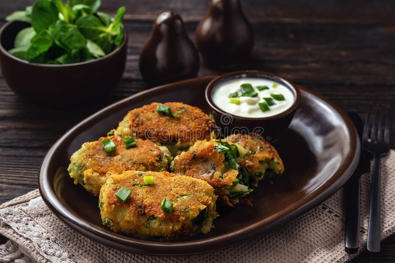 Homemade potato and spinach croquettes with yogurt dip. Homemade potato and spinach croquettes with yogurt dip stock photos