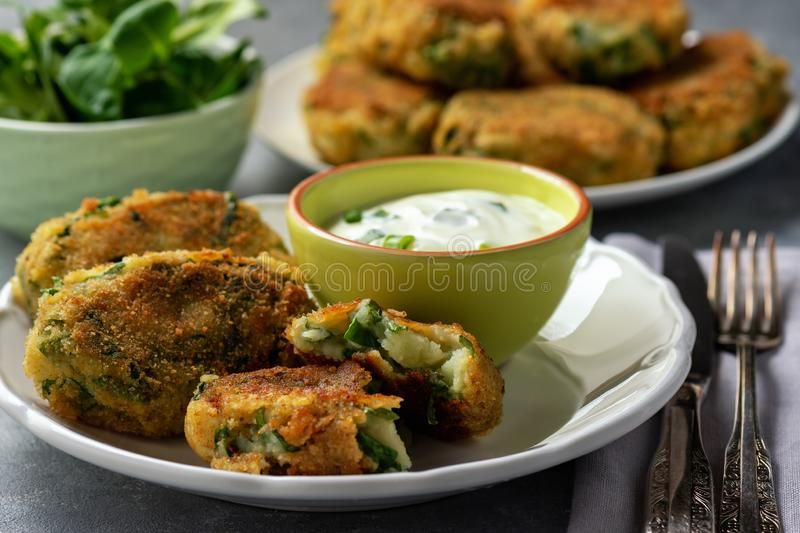 Homemade potato and spinach croquettes with yogurt dip. Homemade potato and spinach croquettes with yogurt dip royalty free stock image