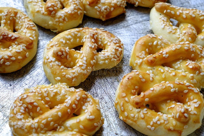 Homemade pretzels with sesame landscape side detail royalty free stock photo