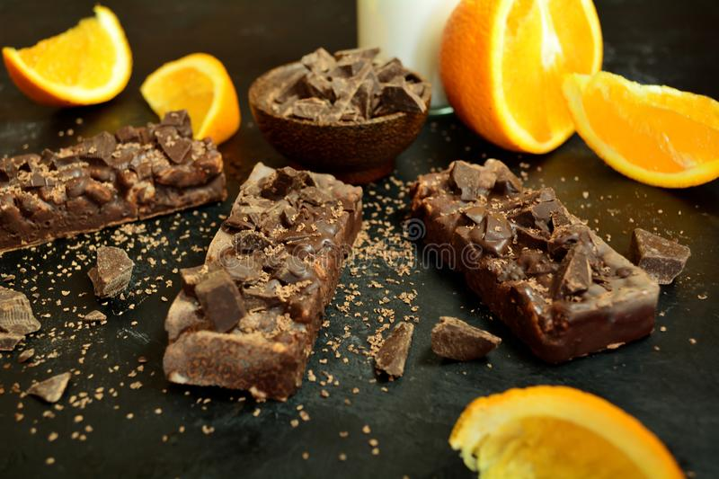 Chocolate Protein Bars with Oranges and Dried Fruit stock photos