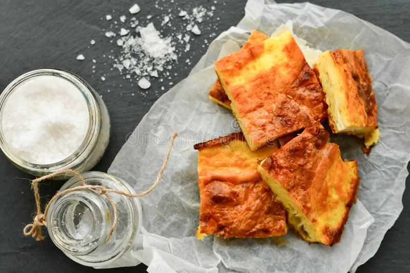 Cheese pie. Homemade puff cheese pie with filo pastry and organic free-range eggs royalty free stock image