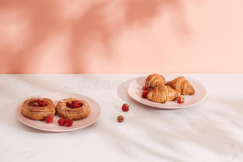 Homemade puff pastry with raspberries. Sweet tasty dessert. decorated with powdered sugar.  stock photography
