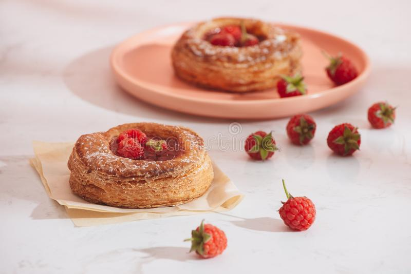 Homemade puff pastry with raspberries. Sweet tasty dessert. decorated with powdered sugar.  stock photos