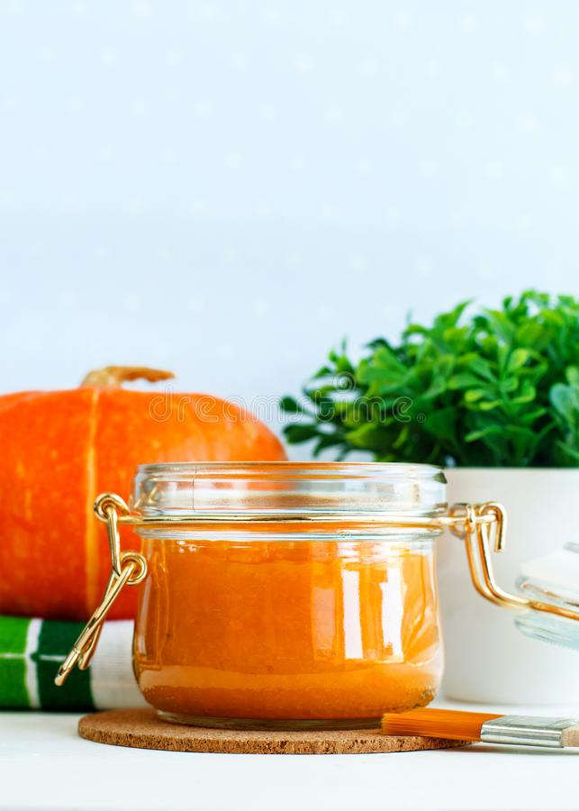 Homemade pumpkin face mask in a glass jar. DIY cosmetics and spa. Copy space. stock images