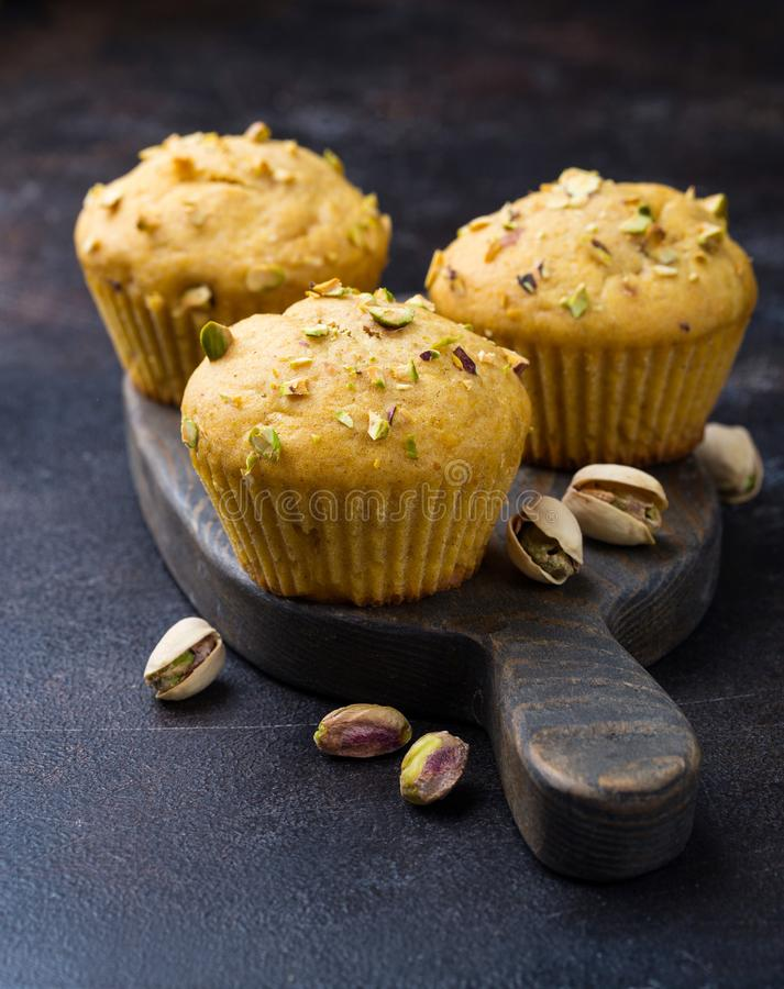 Homemade pumpkin muffins with pistachio royalty free stock images