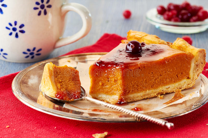 Homemade pumpkin pie with red currant jam and cranberries stock photo