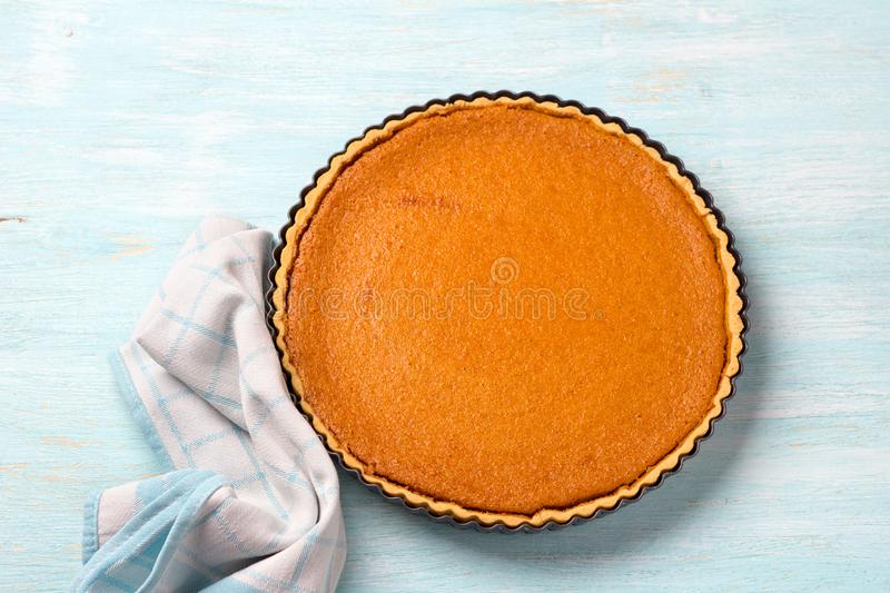 Homemade pumpkin pie in the shape of a blue background royalty free stock image