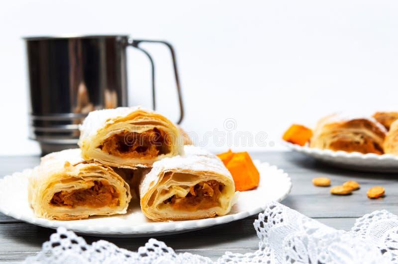 Homemade Pumpkin pie with sugar on white stock image
