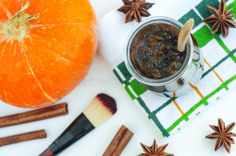 Homemade pumpkin spice facial mask/scrub made with ripe pumpkin puree, sugar and honey, cinnamon powder and ground coffee. DIY cosmetics recipe. Copy space stock photos