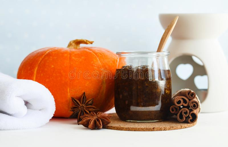 Homemade pumpkin spice facial mask/scrub made with ripe pumpkin puree, sugar and honey, cinnamon powder and ground coffee. royalty free stock image