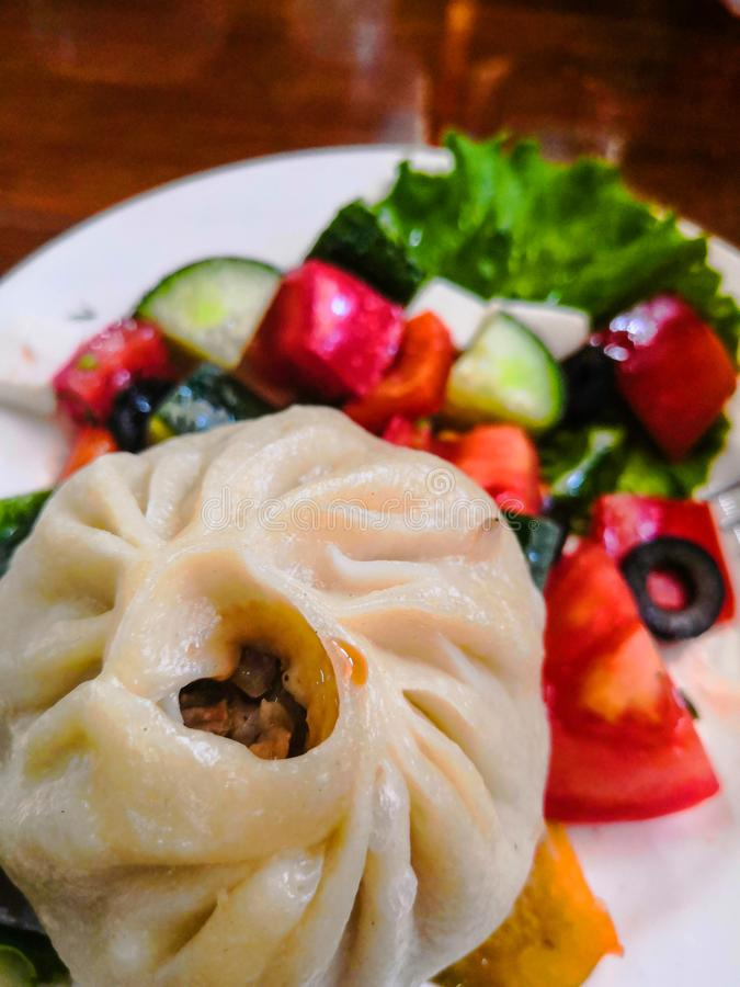 Homemade puzi is traditional for Buryats. Consists of spiced minced meat in pastry. Steam. stock images