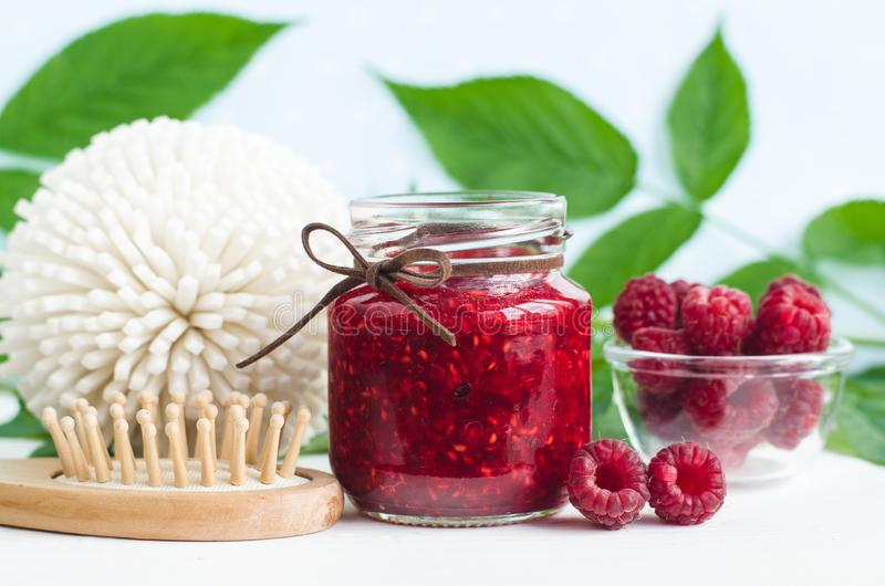Homemade raspberry face and hair mask/scrub in a glass jar. DIY cosmetics and spa. Copy space royalty free stock photography