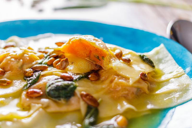 Homemade ravioli with pumpkin on a blue plate partial blur stock images