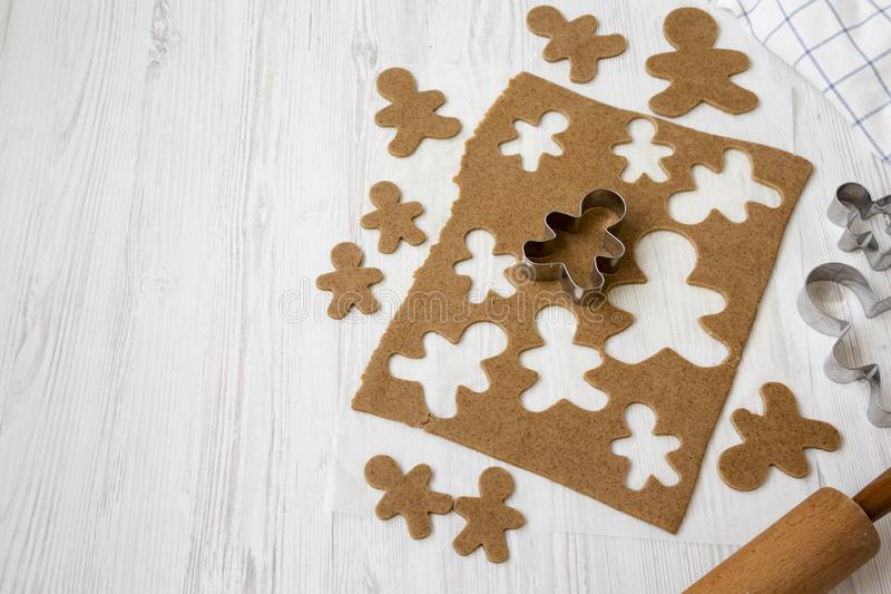 Homemade raw dough for making Christmas cookies on a white wooden surface, low angle view. Space for text stock photography