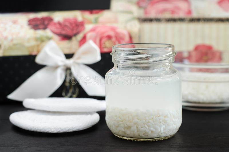 Homemade rice water - natural toner for skin and hair care. DIY cosmetics. Homemade rice water - natural toner for skin and hair care. DIY organic cosmetics stock photography