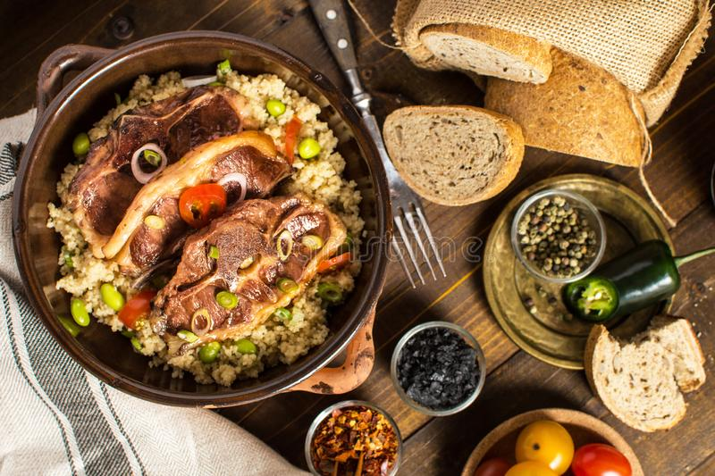 Homemade Roasted Lamb Loin Chops with Couscous and Soybean stock photos
