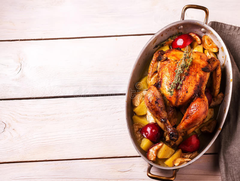 Homemade Roasted Thanksgiving Day Turkey on white wooden background. royalty free stock photography