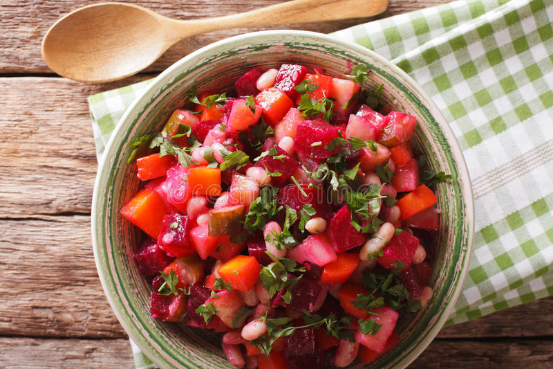 Homemade Russian vegetable salad in bowl close up. horizontal t royalty free stock images