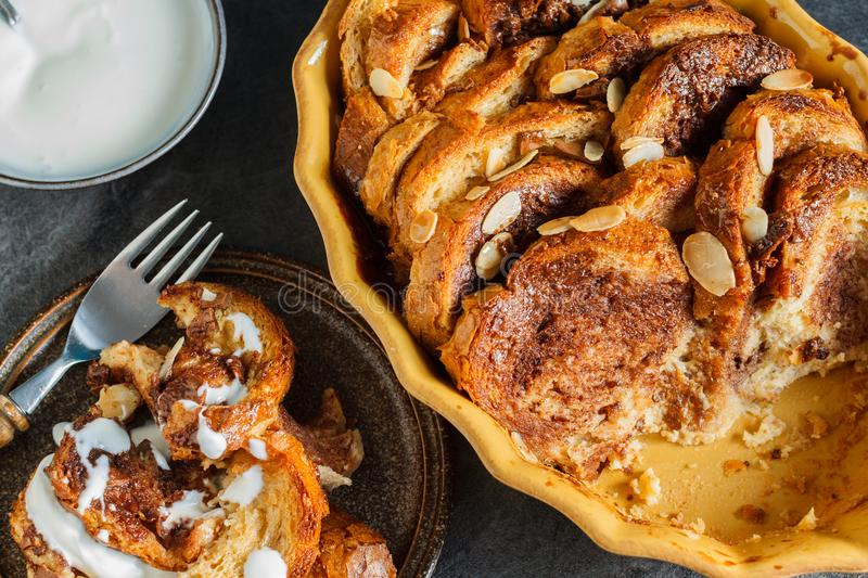 Homemade rustic bread pudding with chocolate and almonds royalty free stock image