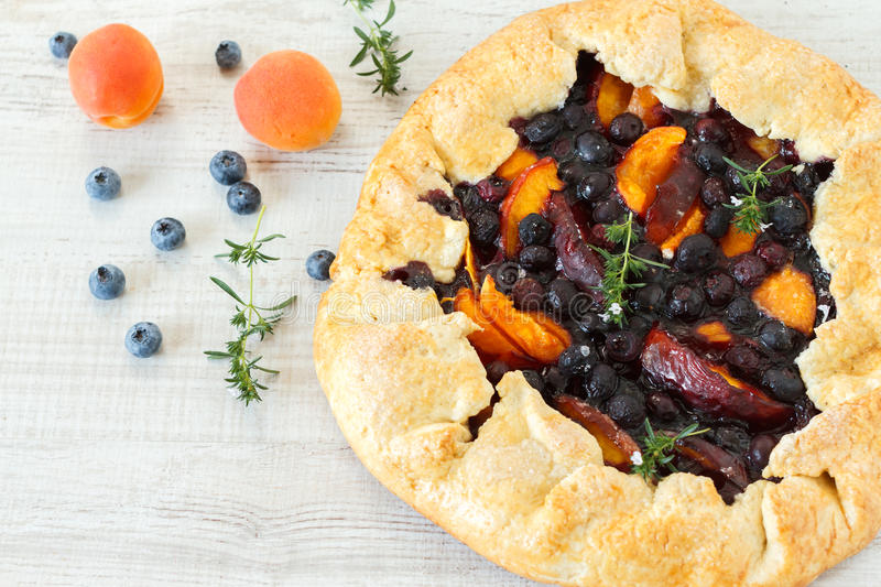 Homemade rustic fruit galette royalty free stock photography