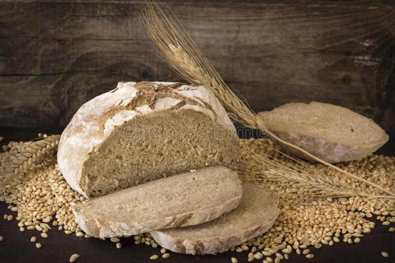 Homemade rye bread. On wooden background royalty free stock image