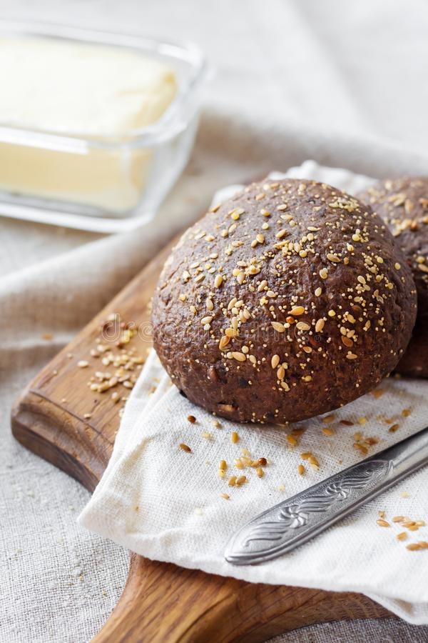 Homemade rye buns with linseeds, sesame and white poppy seeds stock photo
