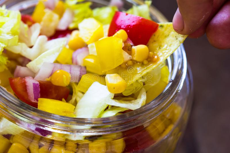 Homemade salad in glass jar with corn salad and vegetables. Healthy food, diet, detox, clean eating and vegetarian concept with co stock image