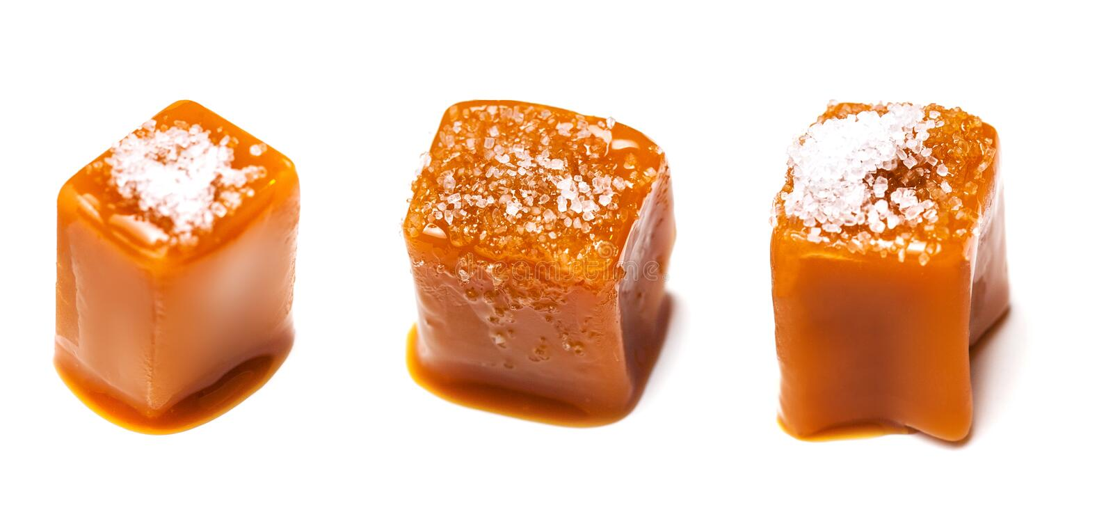 Homemade salted caramel pieces isolated on white background. Golden Butterscotch toffee candy caramels macro. Homemade salted caramel pieces isolated on white stock image