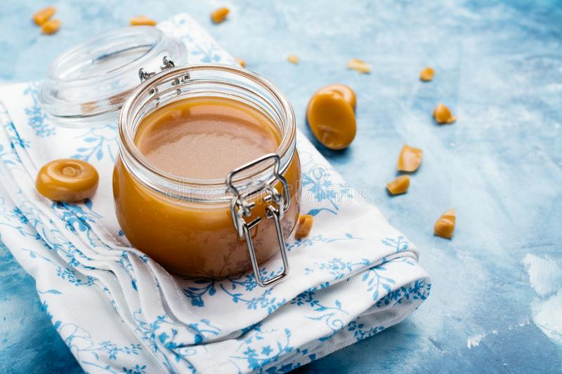 Homemade salted caramel sauce in a glass jar royalty free stock image