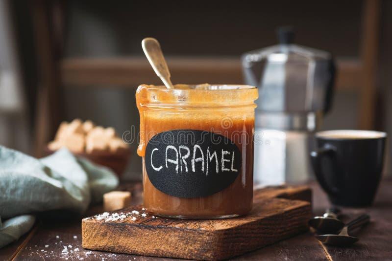 Homemade salted caramel sauce in a jar royalty free stock photos