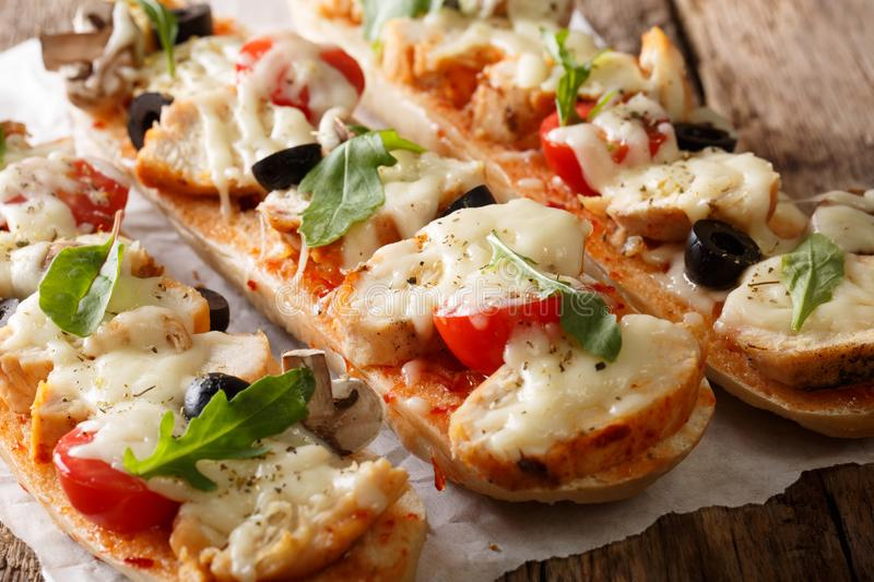 Homemade sandwich pizza baguette baked with chicken, cheese, tom stock photo