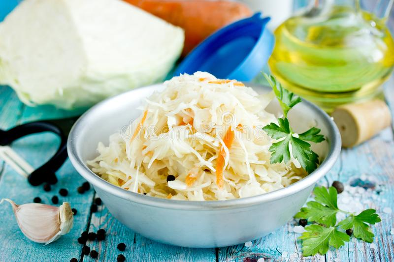 Sauerkraut with carrot and spices, sweet and sour white cabbage stock photo
