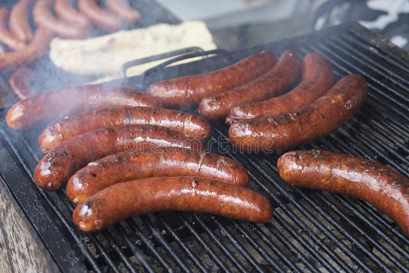 Homemade sausages roasted in barbecue and in oil royalty free stock photo