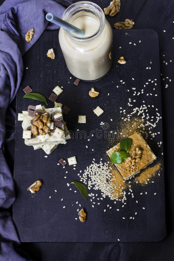 Homemade sesame burfi with walnut milk. Raw healthy vegan dessert. stock images