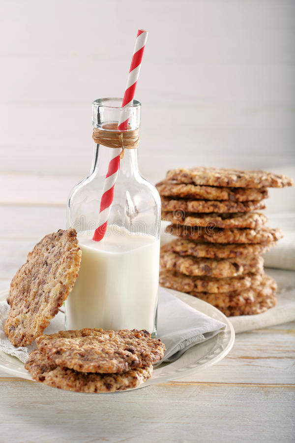 Homemade shortbread biscuits with dark chocolate. And bottle of milk stock image