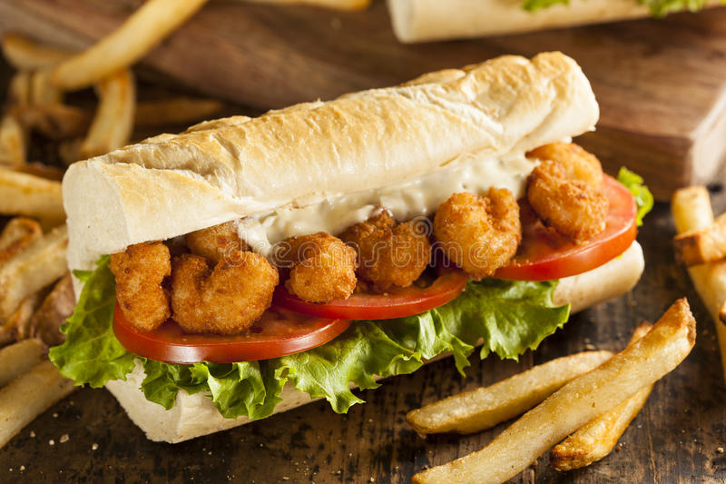 Homemade Shrimp Po Boy Sandwich. With French Fries stock image