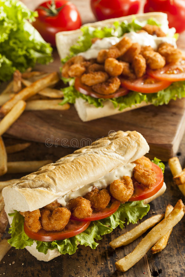 Homemade Shrimp Po Boy Sandwich. With French Fries royalty free stock image