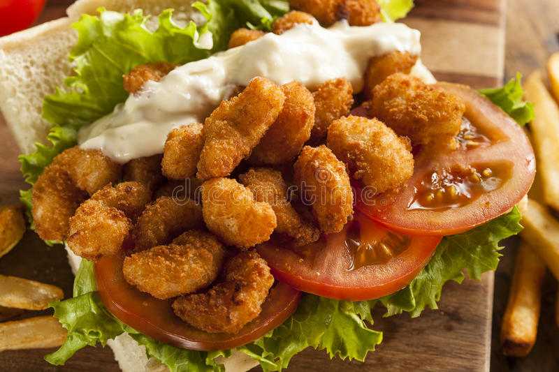 Homemade Shrimp Po Boy Sandwich. With French Fries royalty free stock photography