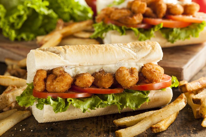Homemade Shrimp Po Boy Sandwich. With French Fries royalty free stock photos