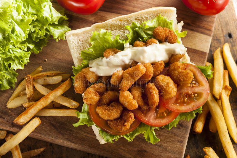 Homemade Shrimp Po Boy Sandwich. With French Fries stock photography