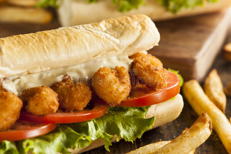 Homemade Shrimp Po Boy Sandwich. With French Fries stock images