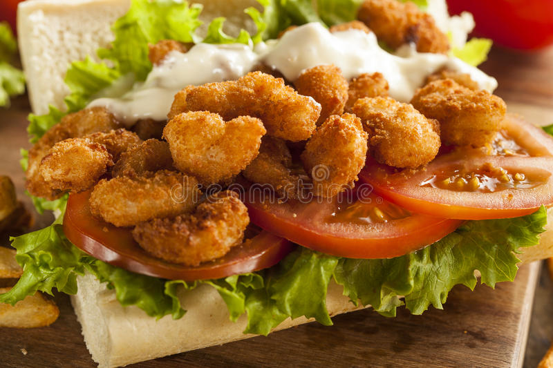 Homemade Shrimp Po Boy Sandwich. With French Fries stock photo