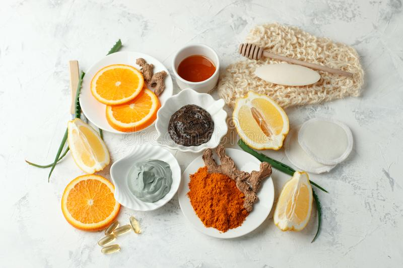 Homemade skin care and body scrub and mask with natural ingredients honey, lemon, clay, coffee grain, aloe vera, oranges set up on stock images